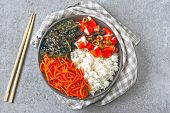 Colorful poke a bowl with seaweed and crab meat. Vegetarian poke bowl. Top view. poster
