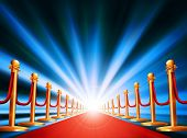 A red carpet leading to somewhere exciting with bright light and abstract background poster
