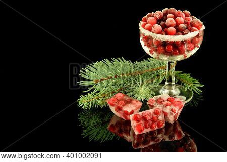 Frozen Delicious Cranberries In A Glass And Some Brequettes With Frozen Cranberries On The Black Ref