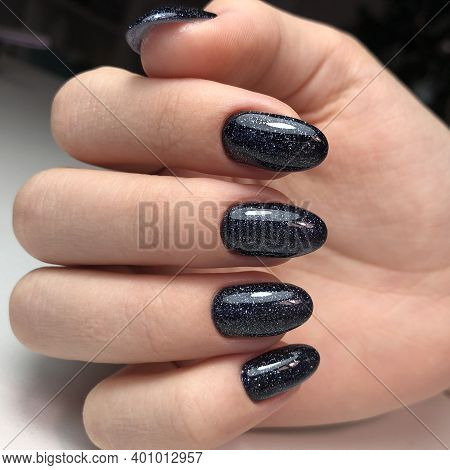 Stylish Trendy Black Female Manicure.hands Of A Woman With Black Manicure On Nails