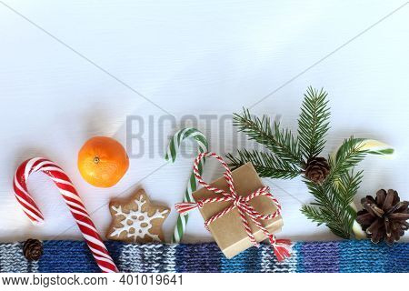 Flat Lay Of Festive Items On A Light Surface Top View. Colorful Mood For Christmas
