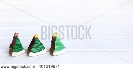 Three Decorative Wooden Christmas Trees Decorated With Stars On A Light Surface Front View. Ecologic