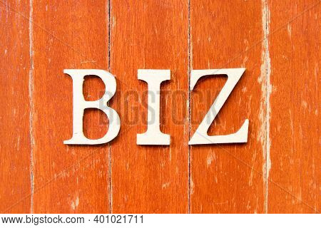 Alphabet Letter In Word Biz (abbreviation Of Business) On Old Red Color Wood Plate Background