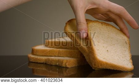 Man Taking Piece Of Bread. Stock Footage. Close-up Of Man Taking Fresh Slice Of Sliced Bread On Isol