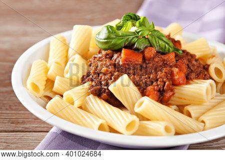 Macaroni Bolognese On A Plate. Typical Italian Dish.