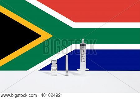 Flag Of South Africa Illustrating Campaign For Global Vaccination Against Covid-19. Epidemic Virus