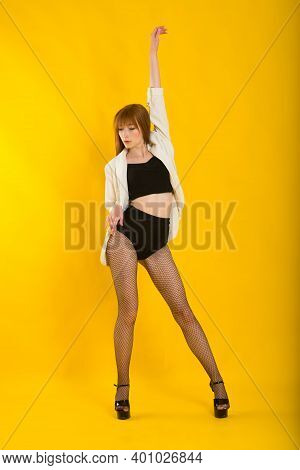 Full Length Studio Portrait Of Beautiful Woman In Plaid Jacket, White Polka Dot Tights And Boots
