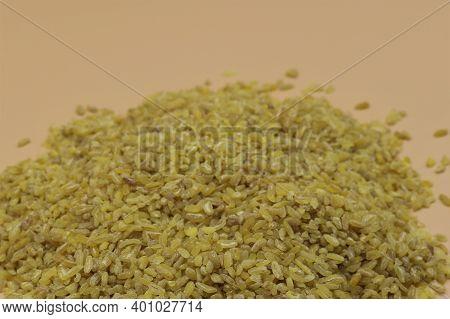 Pile Of Bulghur Raw Grain On Background.