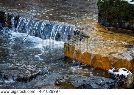 Small Waterfalls On The River, Limestone Layers Painted In Orange With Iron Ochre, Territory Of Glan