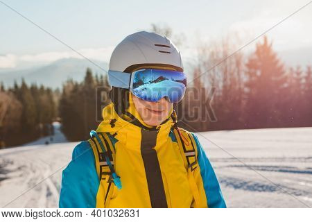 Portrait Of Woman Skier On The Hill