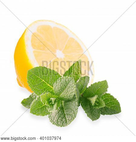 Half Lemon Fruit With Meant Leaves Isolated On White