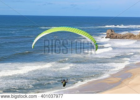 Paraglider Flying Above Victory Walls Beach, Portugal