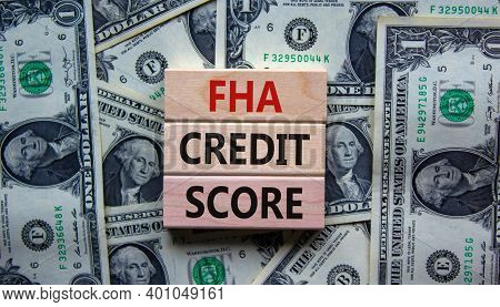 Fha Credit Score Symbol. Concept Words 'fha Credit Score' On Wooden Blocks On A Beautiful Background