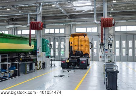 Servicing And Repairing Trucks In A Large Garage. Car Service And Truck Maintenance. Auto Mechanic C