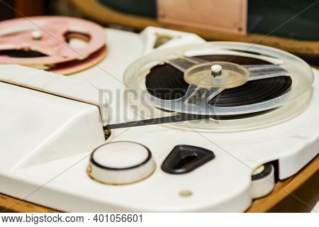 Vintage Tape Recorder Is Playing Music, Close Up. Vintage Tape Recorder Roller