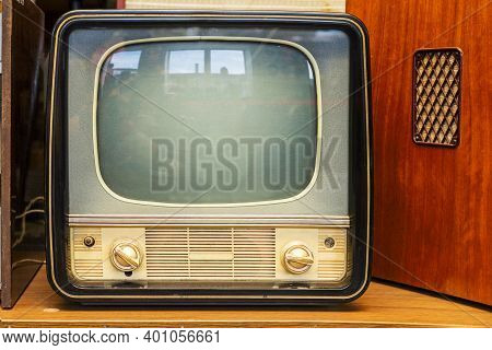 Vintage Television Set At The Shop. Old Television Set Is Placed In The Electrical Stores.