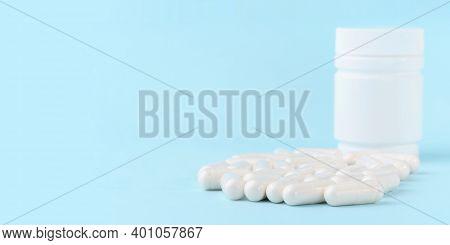 Medical Capsules Of Glucosamine Chondroitin, Amino Acids, Maltodextrin On Blue Surface. Pharmaceutic