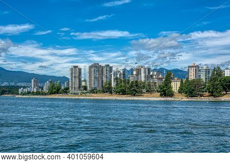 View On West Part Of Vancouver Downtown With Cloudy Sky Background