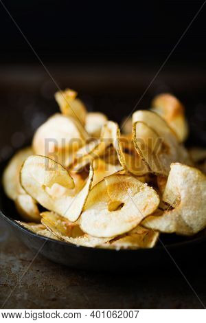 Close Up Of Rustic English Pub Grub Ribbon Cut Potato Crisps