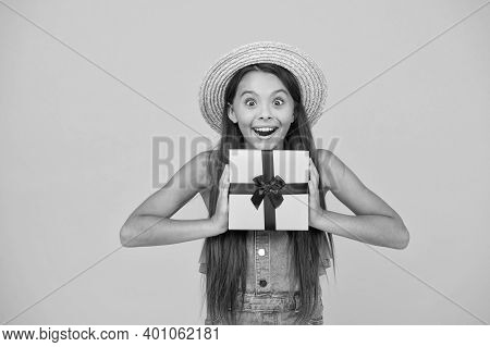 Its Time For Surprise. Happy Girl Hold Gift Yellow Background. Surprise Box. Surprised Look Of Littl