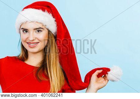 Xmas, Seasonal Clothing, Winter Christmas Concept. Young Smiling Positive Woman Wearing Santa Claus