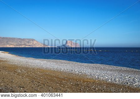 Beach Of Altea With View To The Rock Of Calpe Over Deep Blue Ocean At A Sunny Cloudless Day, Costa B