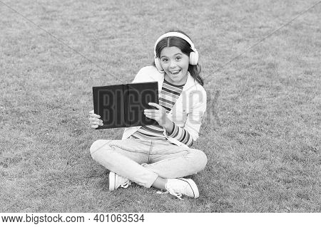 Be Smart. Cute Girl Read Book. Happy Preschool Girl With Book In School Yard. Back To School. Hardwo