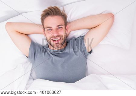 New Smile, New Day. Happy Man Awaken In Bed. Handsome Caucasian Man With Happy Smile Relaxing In The
