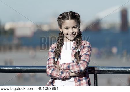Girl Cute Kid With Braids Relaxing Urban Background Defocused. Organize Activities For Teenagers. Va