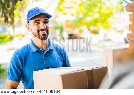 Portrait Of A Delivery Man Carrying Packages