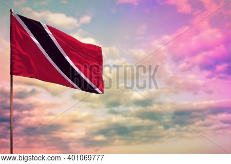 Fluttering Trinidad And Tobago Flag Mockup With The Place For Your Text On Colorful Cloudy Sky Backg