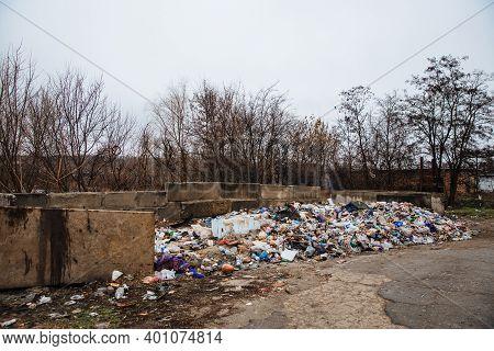 Dneprorudnoe, Ukraine - January 29 2020:garbage Dump On The Grass Near The Garages. Ecological Catas