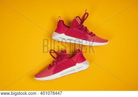 Pair Of New Pink Sneakers, Sport Shoes On Yellow Background. Pink Womens Sport, Running Shoes
