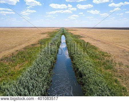 Irrigation Canal In A Desert Or Steppe Area.