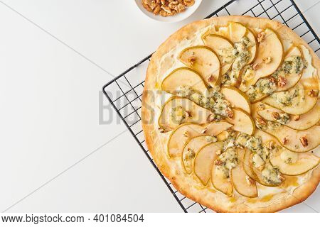 Part Of Fruit Homemade Sweet Pear Pizza With Cheese And Honey, Rustic Italian Savory Food With Pastr