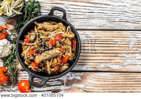 Udon Stir Fry Noodles With Chicken And Vegetables In A Pan. White Background. Top View. Copy Space