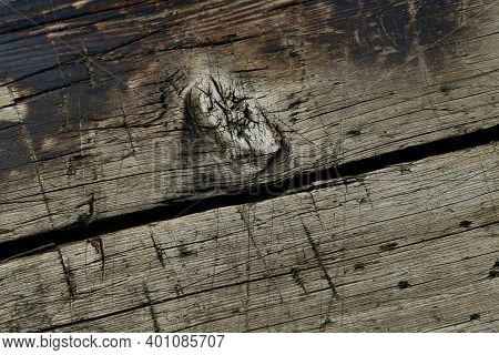 A Wooden Background Diagonally Located Boards. With A Slit Dividing The Picture In Half And Dried A
