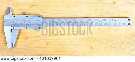 Caliper With Centimeter And Millimeter On Wooden Bench