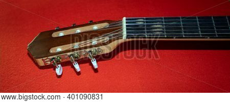 Guitar Headstock With Tuning Pegs. Color Background