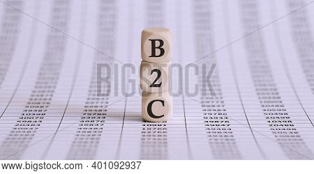 B2c Sign Made Of Wood On Office Table On Chart