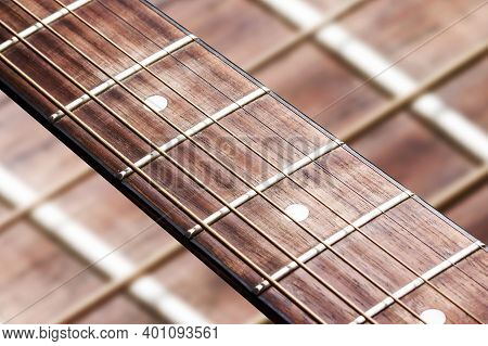 Guitar Fret Isolated. Empty Copy Space Music Background. Wooden Guitar Part Close Up.