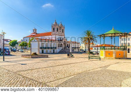 Sanctuary Of Our Lady Of Nazare Catholic Church In Cobblestone Square With Palm Trees In Sitio Hillt