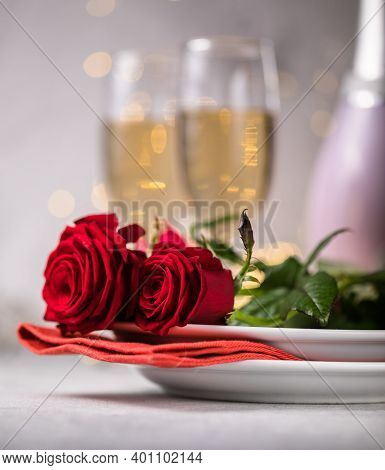 Valentines Day Table Setting  Red Roses And Champagne Glasses On Concrete Background. Valentine 's G