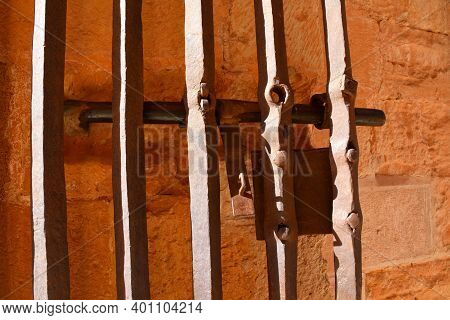 Detail Of Iron Fence With Lock From Medieval Times In The Castle Of Belmonte.