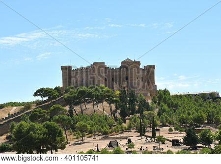 Belmonte Castle On A Hill With Forest Below.