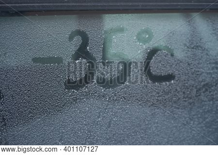 Inscription Minus 35 Degrees Celsius On A Snow-covered Car Window