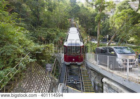 Hong Kong November 2020 : Victoria Peak Tram Climbing Up The Steep Hill, A Funicular Railway And Lan