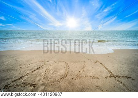 Happy New Year Numbers 2021 Text On Beautiful The Sea Beach With Wave Early Morning Sunrise Over The
