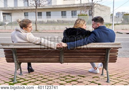 Love Triangle, A Girl Looks At Her Boyfriend And He Shakes Hands With Another Girl, They Are Sitting