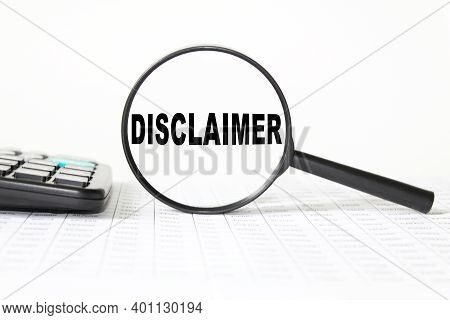 Words Disclaimer N A Magnifying Glass On A White Background. Business Concept